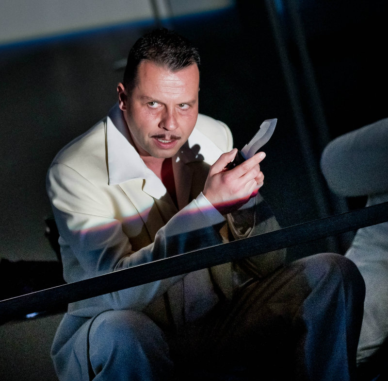 Timothy Dawkins, bass, as Sparafucile in Rigolotto at Grange Park Opera