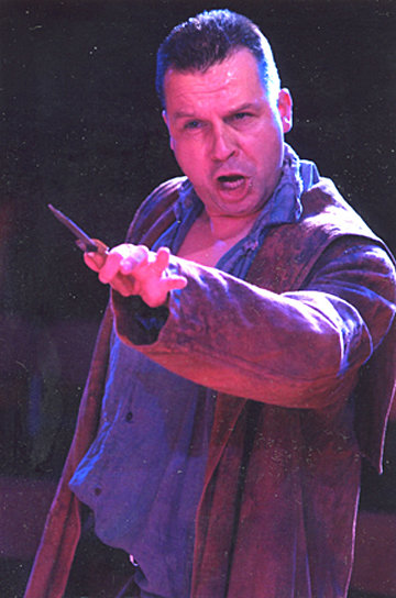Timothy Dawkins, bass, as Sparafucile in Rigoletto, for Longborough Festival